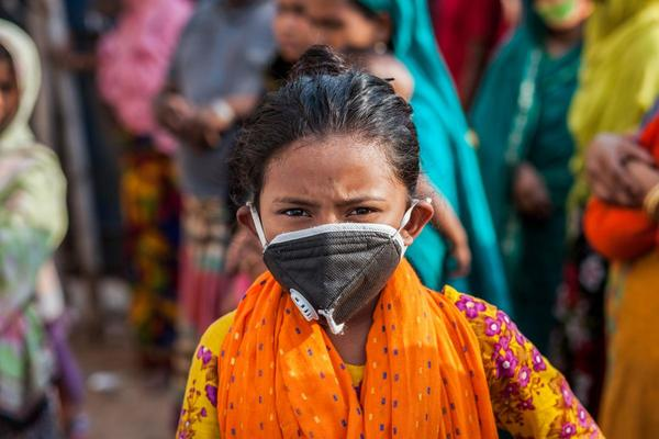A young girl wearing a face mask