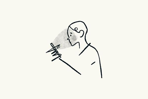 A simple cartoon illustration of a person reading from a handheld device, the glare from the screen projected onto their face